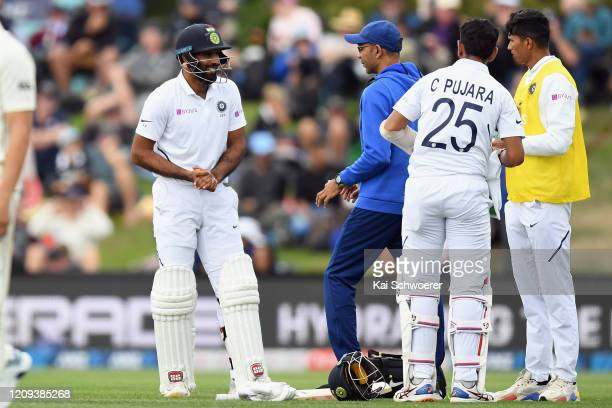 Hanuma Vihari of India receives medical help during day one of the Second Test match between New Zealand and India at Hagley Oval on February 29,...
