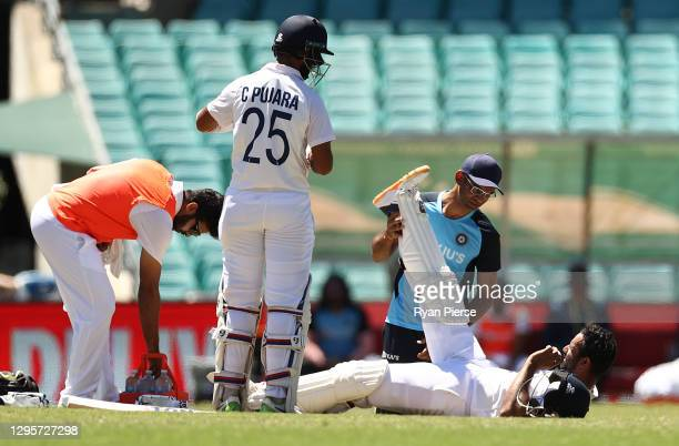 Hanuma Vihari of India receives treatment for a leg injury during day five of the 3rd Test match in the series between Australia and India at Sydney...