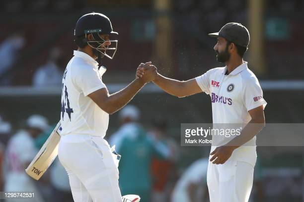 Hanuma Vihari of India shakes hands with his captain Ajinkya Rahane of India as they celebrate securing a draw during day five of the Third Test...
