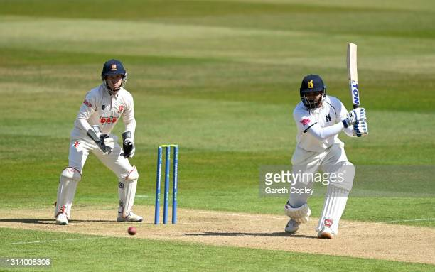Hanuma Vihari of Warwickshire bats watched by Essex wicketkeeper Adam Wheater during the LV= Insurance County Championship match between Warwickshire...