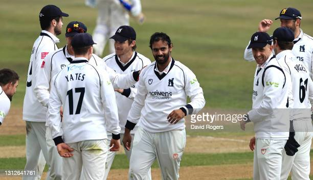 Hanuma Vihari of Warwickshire celebrates with team mates after catching Steven Mullaney during the LV=Insurance County Championship match between...