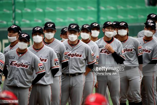 Hanwha Eagles players wear masks before the Korean Baseball Organization League opening game between SK Wyverns and Hanwha Eagles at the empty SK...
