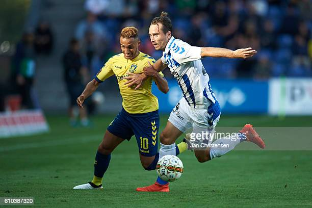 Hany Muhktar of Brondby IF and Oliver Lund of OB Odense compete for the ball during the Danish Alka Superliga match between Brondby IF and OB Odense...