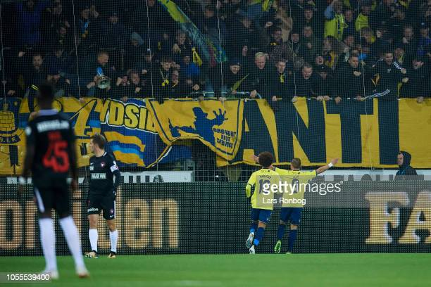 Hany Mukhtar and Uffe Bech of Brondby IF celebrate with the fans after scoring their first goal during the Danish Superliga match between FC...