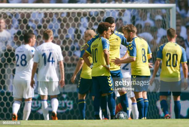 Hany Mukhtar Anthony Jung of Brondby IF and Kasper Fisker of Brondby IF speaking before a freekick during the Danish Alka Superliga match between FC...