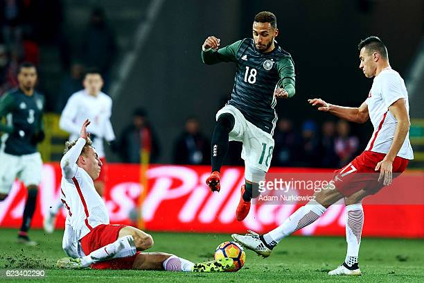 Hany Mukhtar from Germany fights for the ball with Jaroslaw Jach from Poland during the International Friendly soccer match between Poland U21 and...