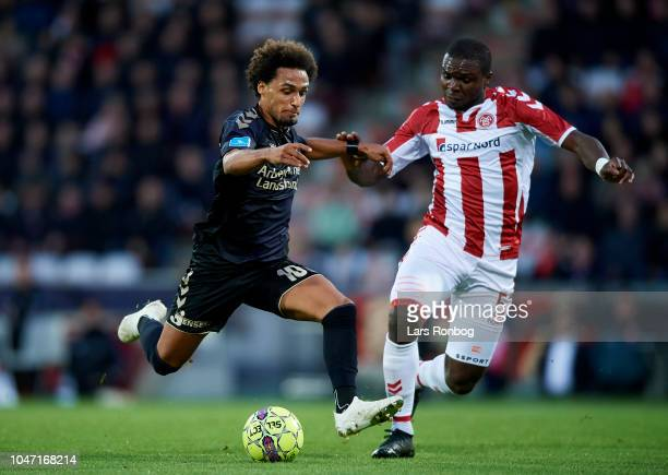 Hany Mukhtar of Brondby IF and Jores Okore of AaB Aalborg compete for the ball during the Danish Superliga match between AaB Aalborg and Brondby IF...