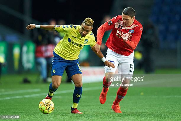 Hany Mukhtar of Brondby IF and Mikkel Cramer of Silkeborg IF compete for the ball during the Danish Alka Superliga match between Brondby IF and...