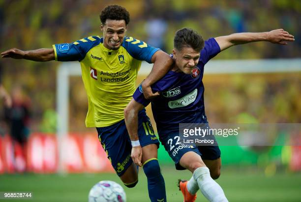 Hany Mukhtar of Brondby IF and Mikkel Duelund of FC Midtjylland compete for the ball during the Danish Alka Superliga match between Brondby IF and FC...
