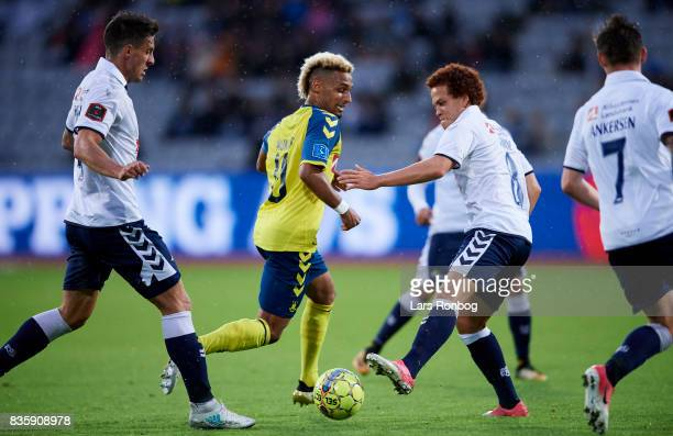 Hany Mukhtar of Brondby IF and Mustafa Amini of AGF Aarhus in action during the Danish Alka Superliga match between AGF Aarhus and Brondby IF at...