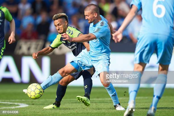 Hany Mukhtar of Brondby IF and Perry Kitchen of Randers FC compete for the ball during the Danish Alka Superliga match between Randers FC and Brondby...