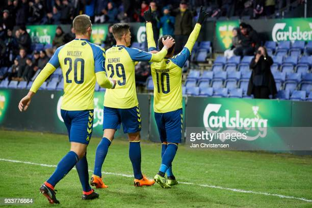 Hany Mukhtar of Brondby IF and teammates celebrate after his 10 goal during the Danish Alka Superliga match between Brondby IF and Hobro IK at...