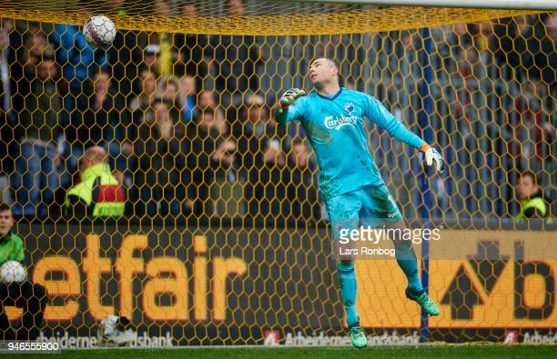 Hany Mukhtar scores the 21 goal against Goalkeeper Stephan Andersen of FC Copenhagen during of Brondby IF the Danish Alka Superliga match between...