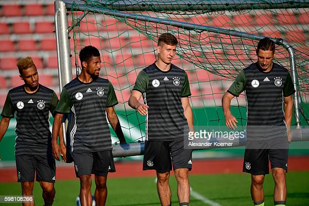 Hany Mukthar Jeremy Dudziak Waldemar Anton and Dominik Kohr of the German U21 carry a goal during the public training session at Auestadion on August...
