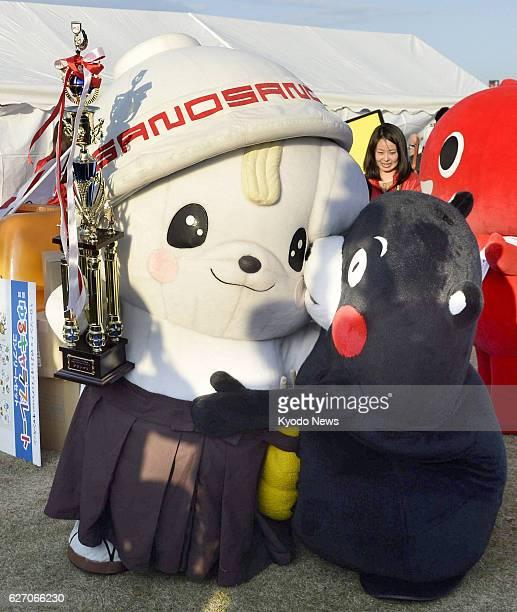 Hanyu Japan 'Sanomaru' the local mascot of Sano Tochigi Prefecture receives congratulations from 'Kumamon' the black bear mascot of Kumamoto...