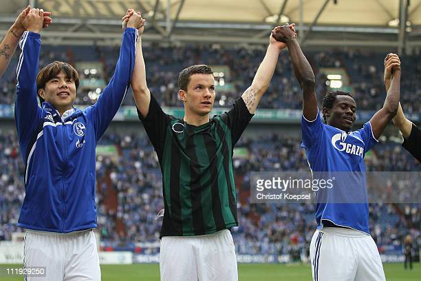 Hao Junmin Alexander Baumjohann and Anthony Annan of Schalke of Schalke celebrate after the Bundesliga match between FC Schalke 04 and VfL Wolfsburg...