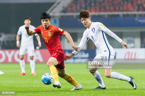 Hao Junmin of China PR battles for the ball with Koh Myongjin of Korea Republic during their 2018 FIFA World Cup Russia Final Qualification Round...