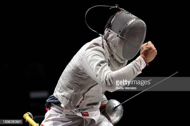 Hao Li of Team China celebrates the victory against Artem Manko of Team Ukraine during the Men's Sabre Individual Category A Final on day 1of the...