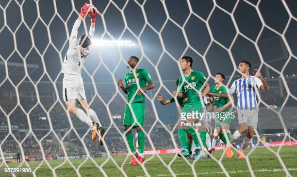 Hao Sen Of Beijing Guoan saves a ball during 2018 China Super League match between Beijing Guoan and Guangzhou RF at Beijing Workers Stadium on May...