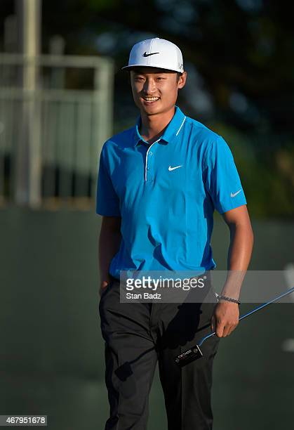 Hao Tong Li of China smiles as he exits the 18th hole during the third round of the Webcom Tour Chitimacha Louisiana Open presented by NACHER at Le...