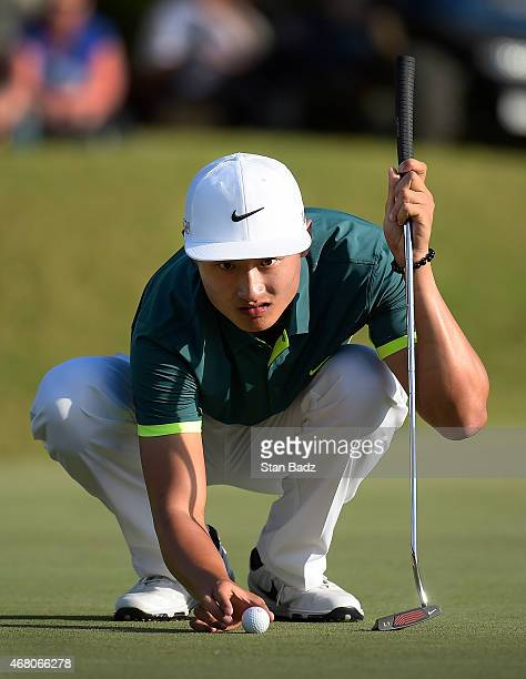Hao Tong Li of China studies his putt on the 18th hole during the final round of the Webcom Tour Chitimacha Louisiana Open presented by NACHER at Le...