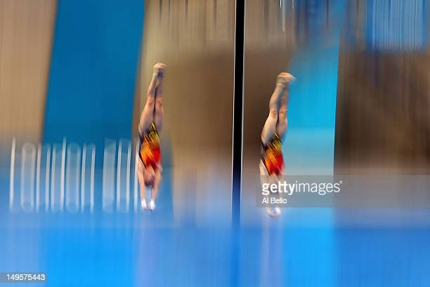 Hao Wang and Chen Rouling of China compete in the Women's Synchronised 10m Platform Diving on Day 4 of the London 2012 Olympic Games at the Aquatics...