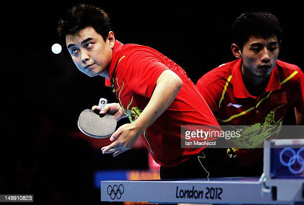 Hao Wang and Jike Zhang of China in action against Timo Boll and Bastian Steger of Germany in the men's team competition during the 2012 London...