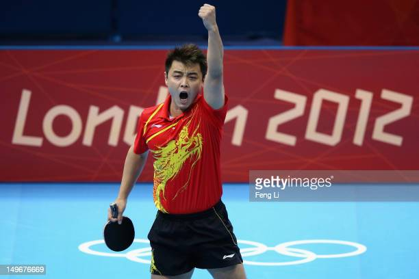 Hao Wang of China celebrates during his Men's Singles Table Tennis semifinal match on Day 6 of the London 2012 Olympic Games at ExCeL on August 2...
