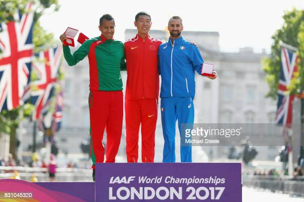 Hao Wang of China gold poses with reallocated medal winners Eder Sanchez of Mexico promoted from Bronze to Silver and Giorgio Rubino of Italy...