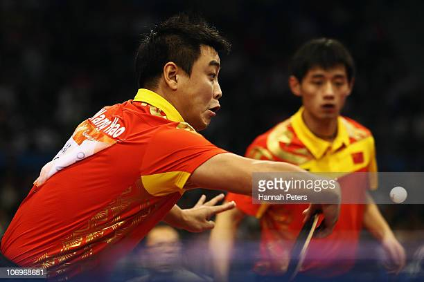 Hao Wang of China plays a backhand in the Men's Doubles Final with Jike Zhang of China against Lin Ma and Xin Xu of China at Guangzhou Gymnasium...
