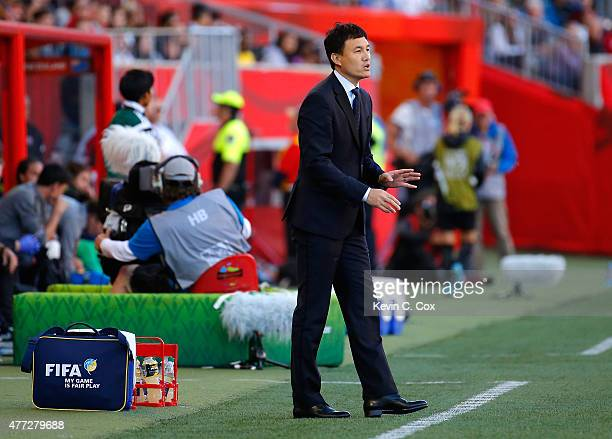 Hao Wei of China PR talks to his team against New Zealand during the FIFA Women's World Cup Canada 2015 Group A match between China PR and New...