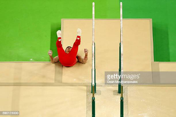 Hao You of China falls at the finish after competing on the Parallel Bars Final on Day 11 of the Rio 2016 Olympic Games at the Rio Olympic Arena on...