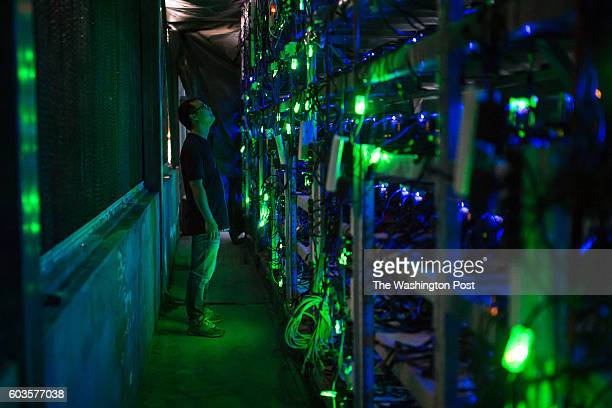 KONGYUXIANG GARZE SICHUAN CHINA AUGUST 12 Haobtc's bitcoin mine site manager Guohua checks mining equipment inside their bitcoin mine near...