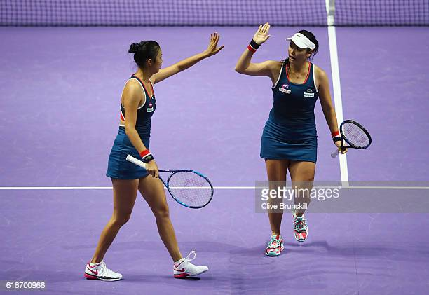 HaoChing Chan and YungJan Chan of Republic of China celebrate in their doubles match against Martina Hingis of Switzerland and Sania Mirza of India...