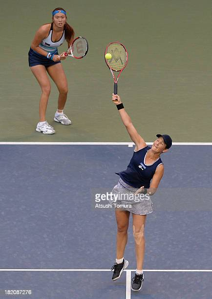 HaoChing Chan of Chinese Taipei and Liezel Huber of the United States in action during their women's doubles final match against Cara Black of...