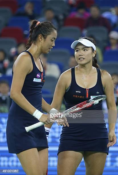 HaoChing Chan of Chinese Taipei and YungJan Chan of Chinese Taipei discuss during the doubles semifinal match against Martina Hingis of Switzerland...