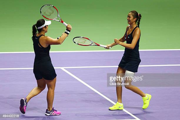 Hao-Ching Chan of Chinese Taipei and Yung-Jan Chan of Chinese Taipei celebrate match point in their round robin match against Bethanie Mattek-Sands...