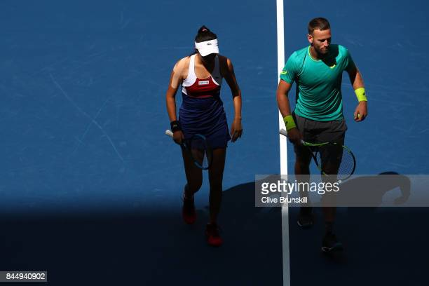 HaoChing Chan of Taiwan and Michael Venus of New Zealand react against Jamie Murray of Great Britain and Martina Hingis of Switzerland during their...