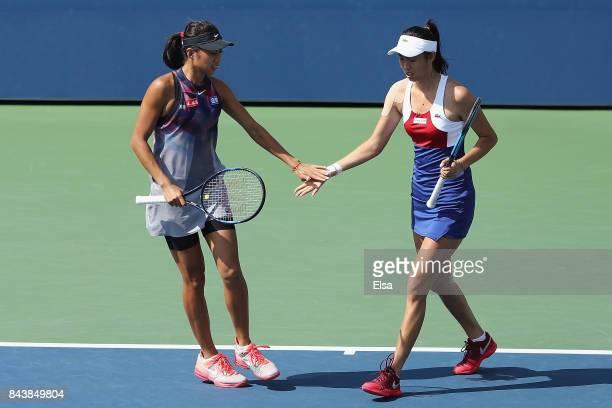 HaoChing Chan of Taiwan and Shuai Zhang of China react after a shot against Martina Hingis of Switzerland and YungJan Chan of Taiwan during their...