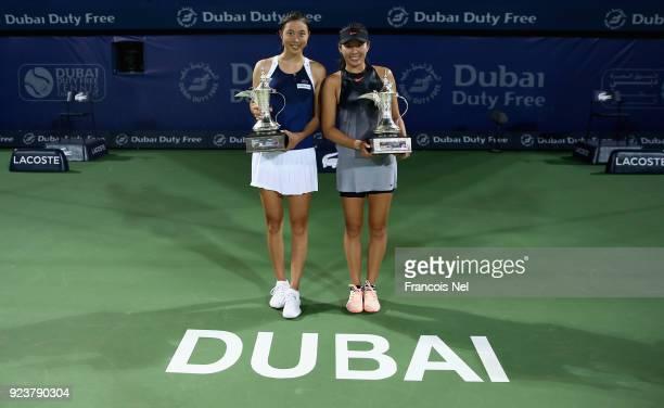 HaoChing Chan of Taiwan and Zhaoxuan Yang of China poses with the trophy after winning the Women's Doubles Final match WTA Dubai Duty Free Tennis...