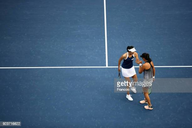 HaoChing Chan of Taiwan and Zhaoxuan Yang of China talk tactics during the Women's Doubles Final match on day six of the of the WTA Dubai Duty Free...