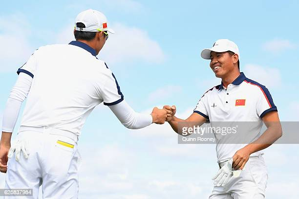 Haotong Li and Ashun Wu of China celebrate a birdie during day three of the World Cup of Golf at Kingston Heath Golf Club on November 26 2016 in...