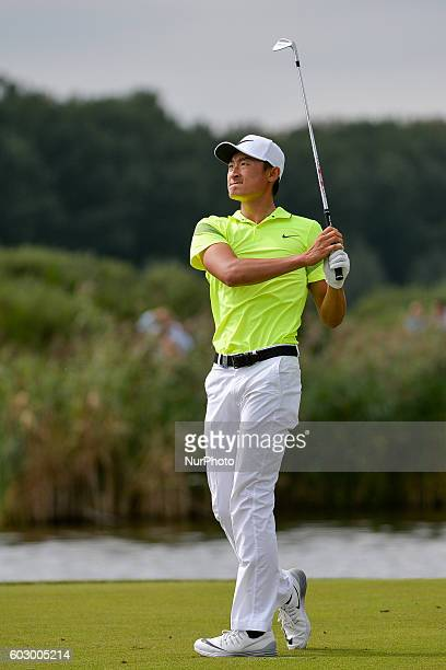 Haotong Li from China hits his 3rd shot onto the 18th Green during the fourth round of the KLM Open held at The Dutch on September 11 2016 in Spijk...