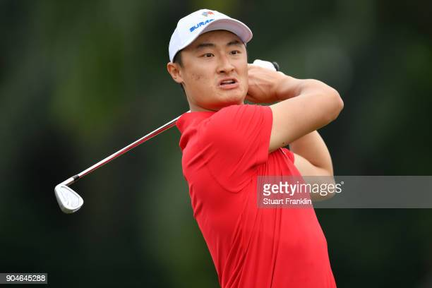 Haotong Li of Asia tees off during the singles matches on day three of the 2018 EurAsia Cup presented by DRBHICOM at Glenmarie GCC on January 14 2018...