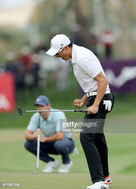 Haotong Li of China celebrates as he holed the winning putt on the 18th green watched by Rory McIlroy of Northern Ireland during the final round of...