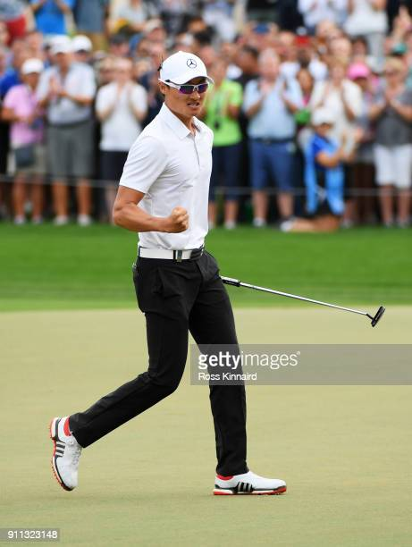 Haotong Li of China celebrates his birdie and victory on the 18th green during the final round on day four of the Omega Dubai Desert Classic at...