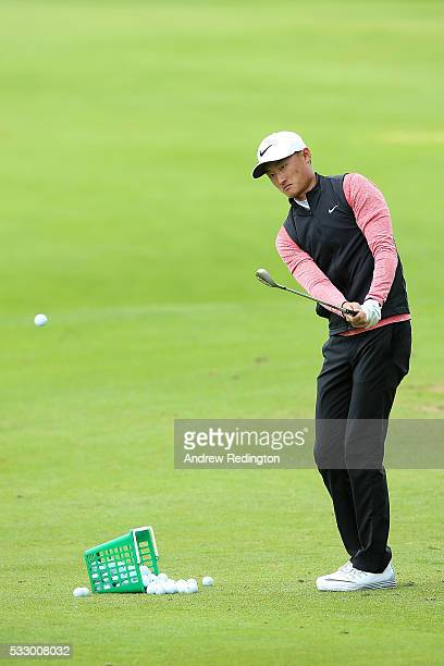 Haotong Li of China chips on the practice ground during the second round of the Dubai Duty Free Irish Open Hosted by the Rory Foundation at The K...