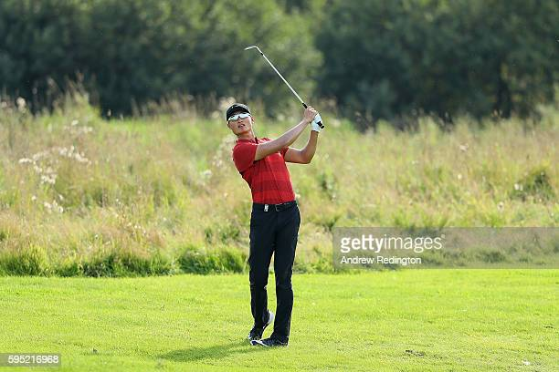 Haotong Li of China hits his second shot on the 14th hole during the first round of Made in Denmark at Himmerland Golf Spa Resort on August 25 2016...
