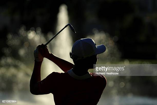 Haotong Li of China hits his second shot on the 18th hole during day two of the Turkish Airlines Open at the Regnum Carya Golf Spa Resort on November...
