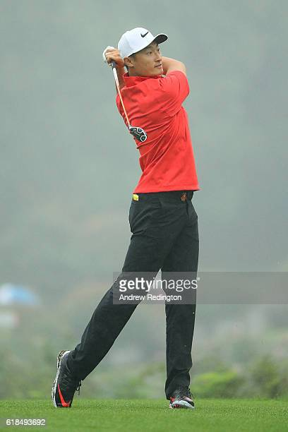 Haotong Li of China hits his second shot on the 2nd hole during day one of the WGC HSBC Champions at Sheshan International Golf Club on October 27...